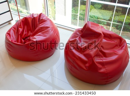 red bubble stools on white floor in modern living room - stock photo