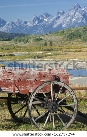 Red Buckboard against the mountains in Montana - stock photo