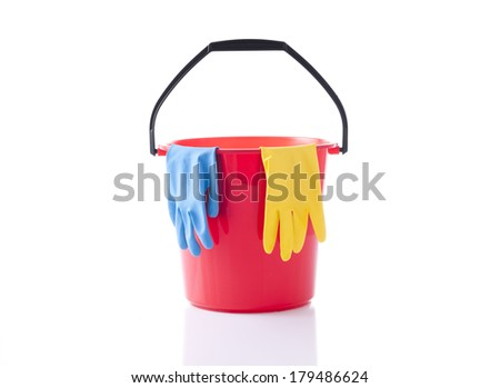red bucket and cleaning gloves - stock photo