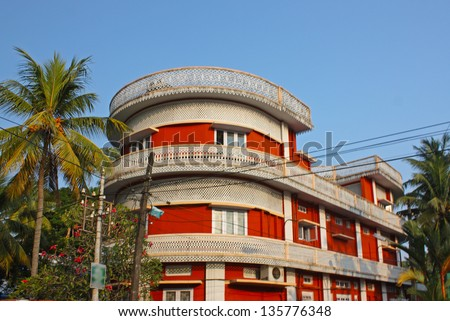Red building and palms taken in Kochi, Kerala,  India - stock photo