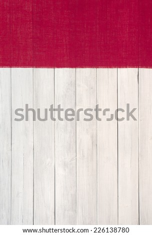 Red Burlap Banner on Side of White Wash Board Background with room or space for copy, text, your words.    Vertical color photo - stock photo