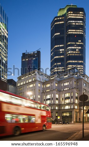 Red Bus in City of London. Night in city of London - stock photo