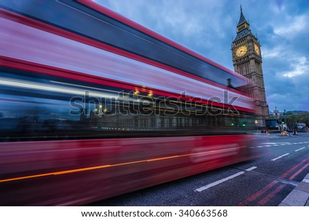 Red Bus in motion in front of Big Ben - London, England  - stock photo