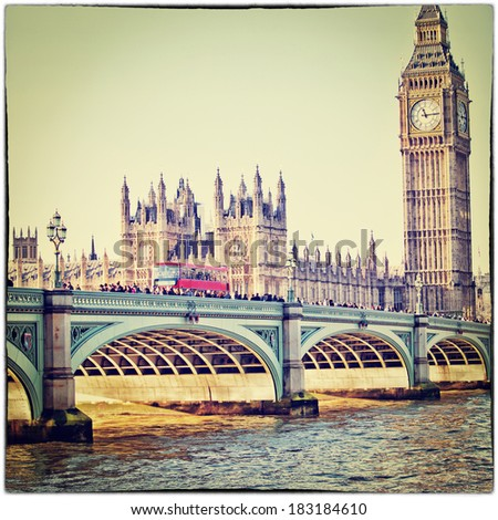 Red bus on Westminster Bridge by the Houses of Parliament with Instagram filter effect - stock photo