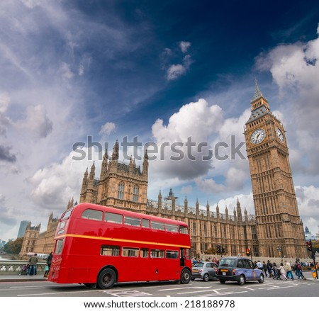 Red bus on Westminster Bridge under a dramatic sky - London. - stock photo