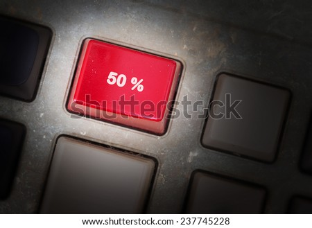 Red button on a dirty old panel, selective focus - 50% - stock photo
