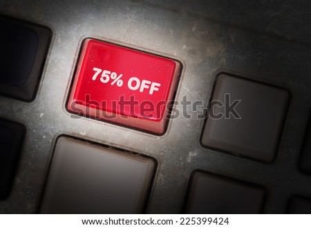 Red button on a dirty old panel, selective focus - 75% off - stock photo