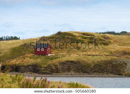 Red cabin and a boat