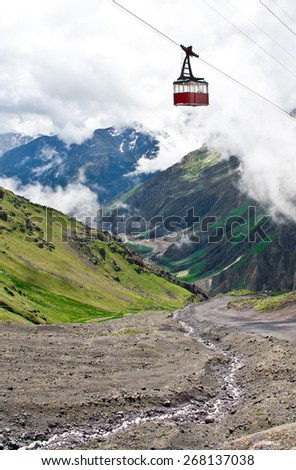 Red cabin in the mountains - stock photo
