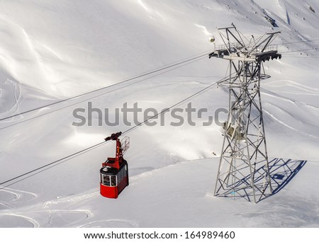 Red cable car in the mountains of Romania (Fagaras, Balea lake), Carpathian Mountains. You can place for logo on the cable car. - stock photo