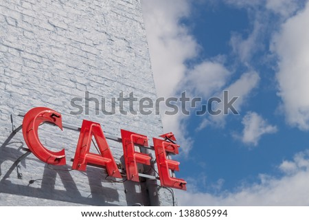 Red Cafe Sign Against Blue Sky - stock photo