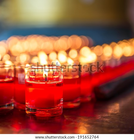Red candle is kindle a fire in glass - stock photo