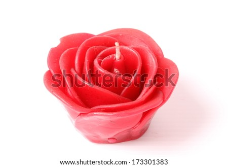 Red candle isolated on white