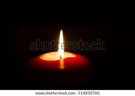 red candle on a black background