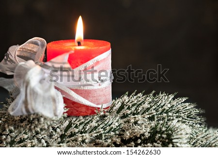 red candle with ribbon with copy space - stock photo