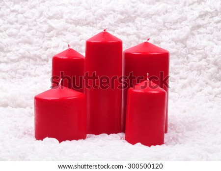Red candles on the white cloth - stock photo