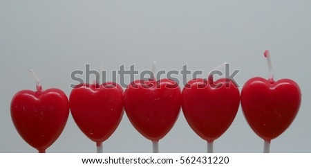 Red candles with white background.