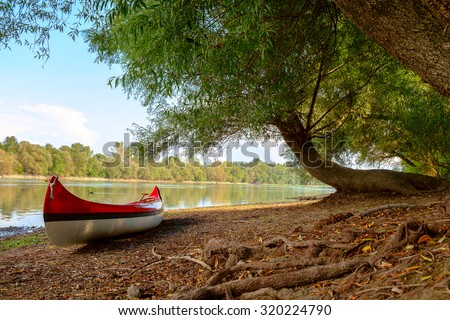 Red canoe on beach at river Danube, Hungary