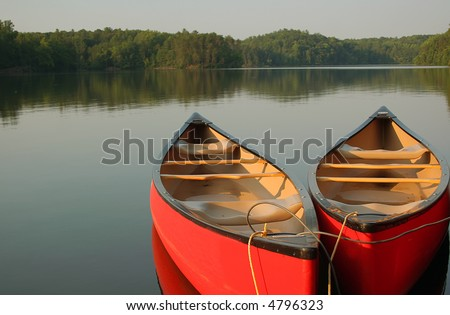 Red canoes on a calm evening at the lake