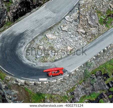 Red car on the Trollstigen road - Norway - stock photo