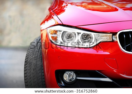 Red car, outdoors - stock photo