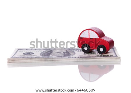 red car over a lot of dollar bills isolated on white  (selective focus) - stock photo