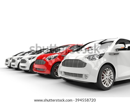 Red Car Stands Out in a Row of White Cars - stock photo