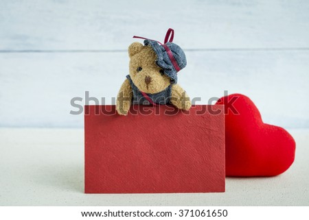 Red card with teddy bear and red heart, valentine concept - stock photo