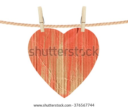 red cardboard heart hang on clothespins isolated on the white background - stock photo