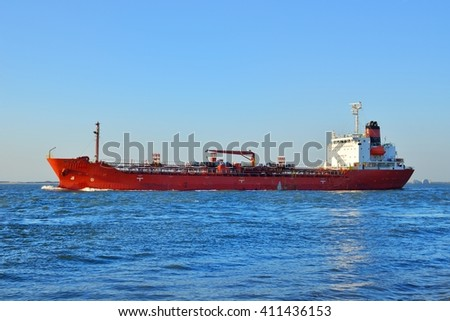 Red cargo ship (tanker) is sailing near Vlissingen, the Netherla