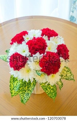 red Carnation bouquet using in wedding or any greeting ceremony - stock photo