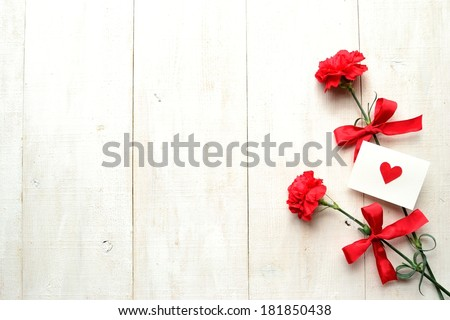 Red carnations with message card.Image of Mothers day. - stock photo