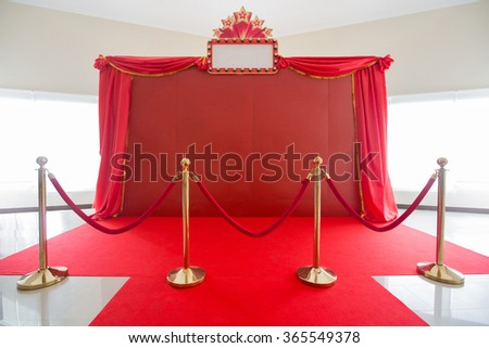 red carpet and rope barrier and backdrop - stock photo
