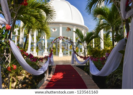 red carpet before the wedding ceremony in a tropical scenery - stock photo