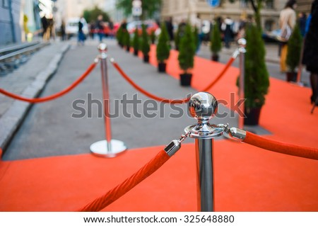 Red Carpet -  is traditionally used to mark the route taken by heads of state on ceremonial and formal occasions - stock photo