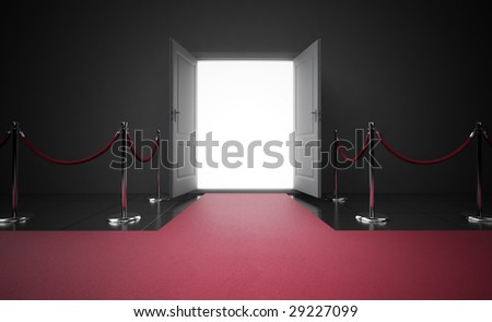 Red carpet leading to the entrance - stock photo