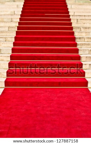 red carpet leading up the stairs - stock photo