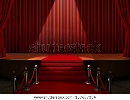 Red Carpet on Stage with Spotlight - stock photo