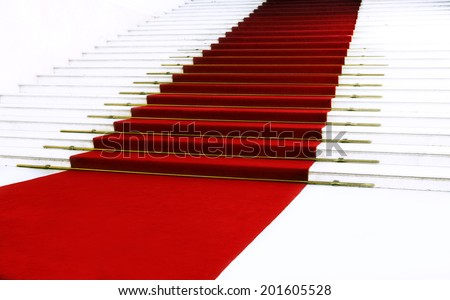 Red carpet on staircase - stock photo