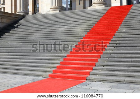 Red carpet stairway, carpet clipping path included - stock photo