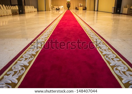 Red carpet with a beautiful pattern for VIP - stock photo