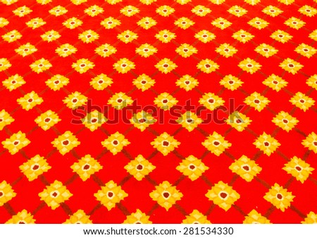 Red carpet with flower pattern in the church of Thai temple. - stock photo