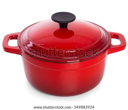 Red cast iron cooking pot, isolated on white background. - stock photo