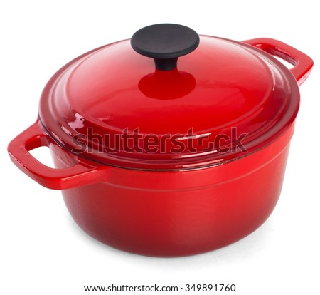 Red cast iron cooking pot with black handle, isolated on white background. - stock photo