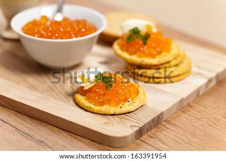 Red caviar canape - stock photo