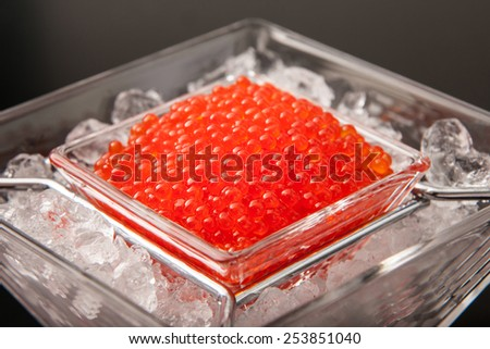Red caviar in glass bowl - stock photo