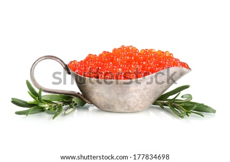 Red caviar in sauceboat with rosemary on a white background - stock photo