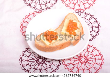 Red caviar with bread - stock photo