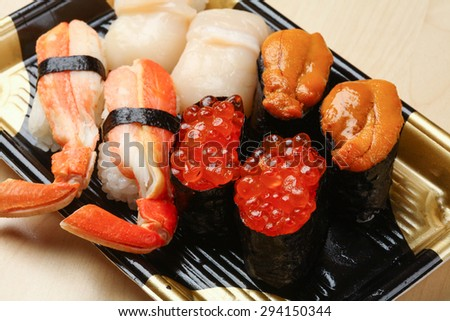 Red caviar with sushi - stock photo