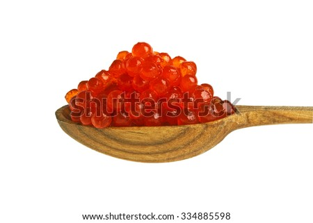 Red caviar with wooden spoon on white background - stock photo